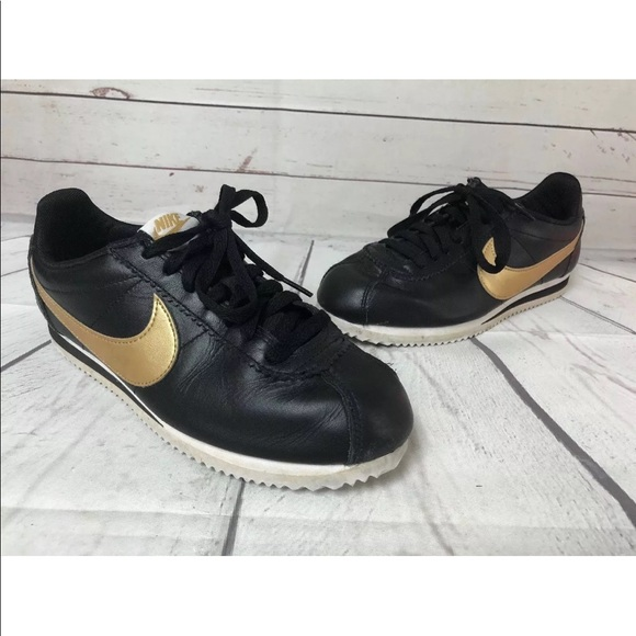 buy online dc074 06dc1 Nike Classic Cortez Leather Black Gold Womens 7.5